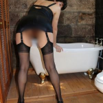 Naughty cougar in black stockings looks so hot